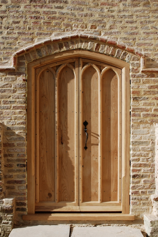 A pair of Solid Oak Boarded Exterior Doors and Frame with Hand Made Ironmongery