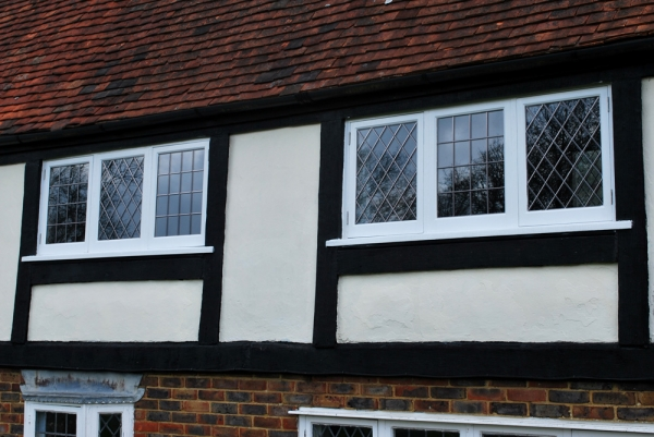 Replaced hardwood windows with a mixture of square and diamond lead lights