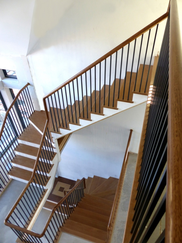 Contemporary Staircase with Oak Continuous Handrail, Oak Treads and Black Metal Balustrades